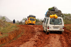 Travelling on the muddy jungle road. Two taxi-brousse minibuses on the muddy jungle road in northern Madagascar Royalty Free Stock Image