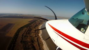 Travelling by private airplane. View from an aircraft wing. Travelling by private airplane. View from an aircraft wing, Full HD stock footage