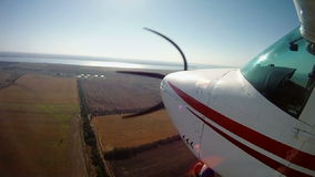 Travelling by private airplane. View from an aircraft wing. stock footage