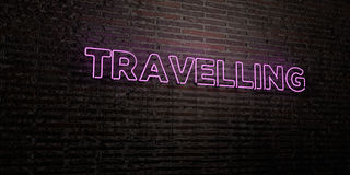 TRAVELLING -Realistic Neon Sign on Brick Wall background - 3D rendered royalty free stock image Royalty Free Stock Photos