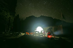 Travelling sitting in a starry night in the mountains Stock Photography