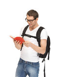 Travelling student. Bright picture of travelling student with backpack and book Royalty Free Stock Image
