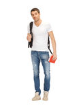 Travelling student. Bright picture of travelling student with backpack and book Stock Photography