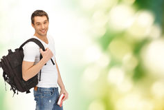 Travelling student with backpack and book Stock Images