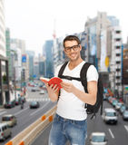 Travelling student with backpack and book Royalty Free Stock Photos
