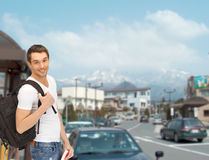 Travelling student with backpack and book Royalty Free Stock Image