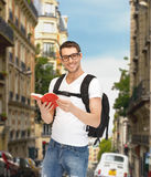 Travelling student with backpack and book Royalty Free Stock Images
