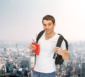 Travelling student with backpack and book Stock Photos