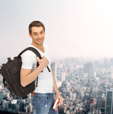 Travelling student with backpack and book Royalty Free Stock Photography