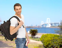Travelling student with backpack and book Stock Photography