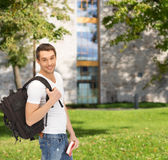 Travelling student with backpack and book Stock Photo