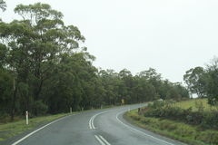 Travelling in Tasmania Country side. Landscape of road travel in rainy season in Tasmania, Australia. Road from Hobart city to Port Arthur Stock Photography