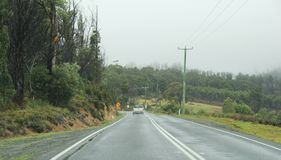 Travelling in Tasmania Country side. Landscape of road travel in rainy season in Tasmania, Australia. Road from Hobart city to Port Arthur Stock Photos