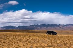 Travelling in Tibet:A car on a desert stock photography