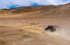 Travelling in Tibet:A car on a desert royalty free stock images