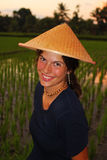 Travelling to Asia. Young woman with traditional conical asian hat Stock Images
