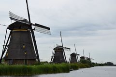 Windmills along the canals of the World Heritage Kinderdijk, Netherlands. Travelling to Holland visiting the windmill park of the UNESCO World Heritage stock photography