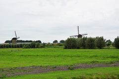 Windmills of the World Heritage Kinderdijk, Netherlands. Travelling to Holland visiting the windmill park of the UNESCO World Heritage Kinderdijk stock photography