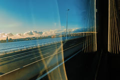 Travelling to Lisbon. Lisbon, November 2012. View of Vasco da Gama bridge on the road from a bus. Armando Rito engineer. 17.2 kilometers, longest in Europe Stock Photos