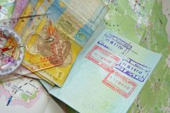 Travelling to Ukraine. Passport with Ukrainian stamp, banknotes and compass on a map od Ukraine Royalty Free Stock Image