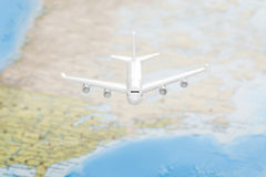 Travelling, tourism, communications and all things related series - plane over world map Stock Photography