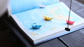 Travelling or tourism concept, planning vacation. Travel and tourism concept, paper boats on the map stock video footage