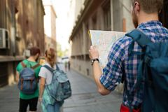 Tourist holding map and sightseeing in city. Travelling tourist holding map and sightseeing in city Royalty Free Stock Photo