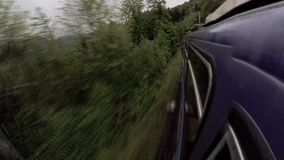 Travelling by train in Switzerland mountains. At spring stock video footage