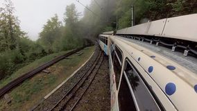 Travelling by train in Switzerland mountains. At spring stock video
