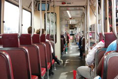 Travelling by tram. People travelling on a tram; urban transport Royalty Free Stock Photography