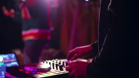 Hand of a DJ mixing in a hip hop show. stock video footage