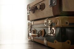 Travelling with a vintage suitcase Royalty Free Stock Photo