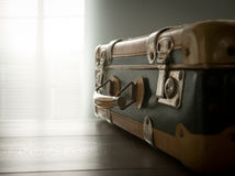 Travelling with a vintage suitcase Stock Images