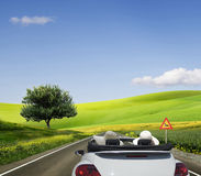 Travelling in a white convertible Royalty Free Stock Image