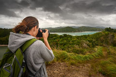 Travelling woman photographer with backpack Royalty Free Stock Image