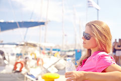 Travelling woman by sea Stock Photos