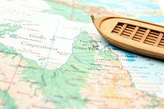 Travelling with a wooden boat Stock Image