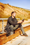 Travelling young man with backpack Royalty Free Stock Image