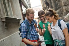 Travelling young people sightseeing. And eating ice creams Stock Image