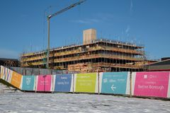 Travelodge construction site Southwater,  built by Mcphillips, with snow,  at Telford Town Centre in Shropshire. Telford, Shropshire, United Kingdom.  December Royalty Free Stock Photography