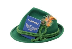 Travels abroad. Blue passport needed when traveling between borders tucked into an alpine hat - path included Royalty Free Stock Photos