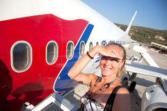 Travels by airplane. A woman travels by airplane Royalty Free Stock Photo
