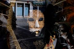 Travels in Europe. The mask in the store on the shop window Venice Italy 25.09.2017 stock images