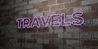 TRAVELS - Glowing Neon Sign on stonework wall - 3D rendered royalty free stock illustration. Can be used for online banner ads and direct mailers Royalty Free Stock Image