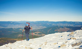 She travels through the mountains. Stock Photography