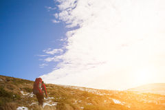 She travels in the mountains. Royalty Free Stock Image
