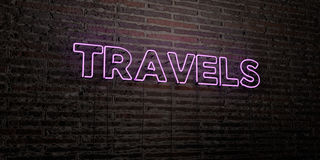 TRAVELS -Realistic Neon Sign on Brick Wall background - 3D rendered royalty free stock image. Can be used for online banner ads and direct mailers Stock Photos