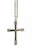 Traversa cristiana d'argento con i piccoli diamanti fotografia stock
