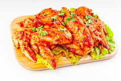 Traversa il pollo volando in marinata Fotografia Stock