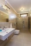 Travertine bathroom. Interior of modern bathroom with travertine walls Stock Photography